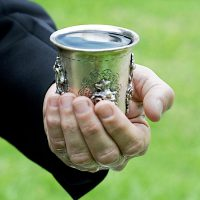 """""""Kiddush cup. A Judaic custom, making a blessing on a cup of wine. Selective focus."""""""